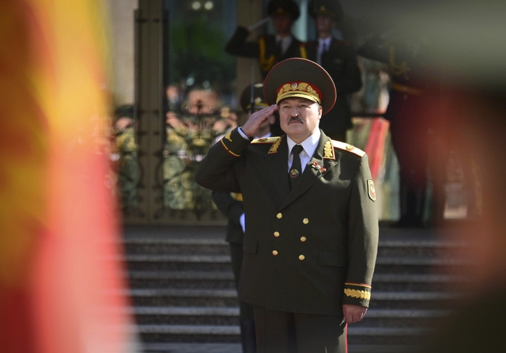 Belarusian President Alexander Lukashenko salutes during his inauguration ceremony at the Palace of the Independence in Minsk, Belarus, Wednesday, Sep...