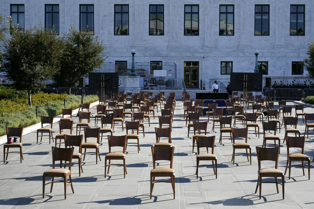 Socially-distant chairs sit on a plaza outside the Supreme Court on Capitol Hill in Washington, Tuesday, Sept. 22, 2020, as preparations take place fo...
