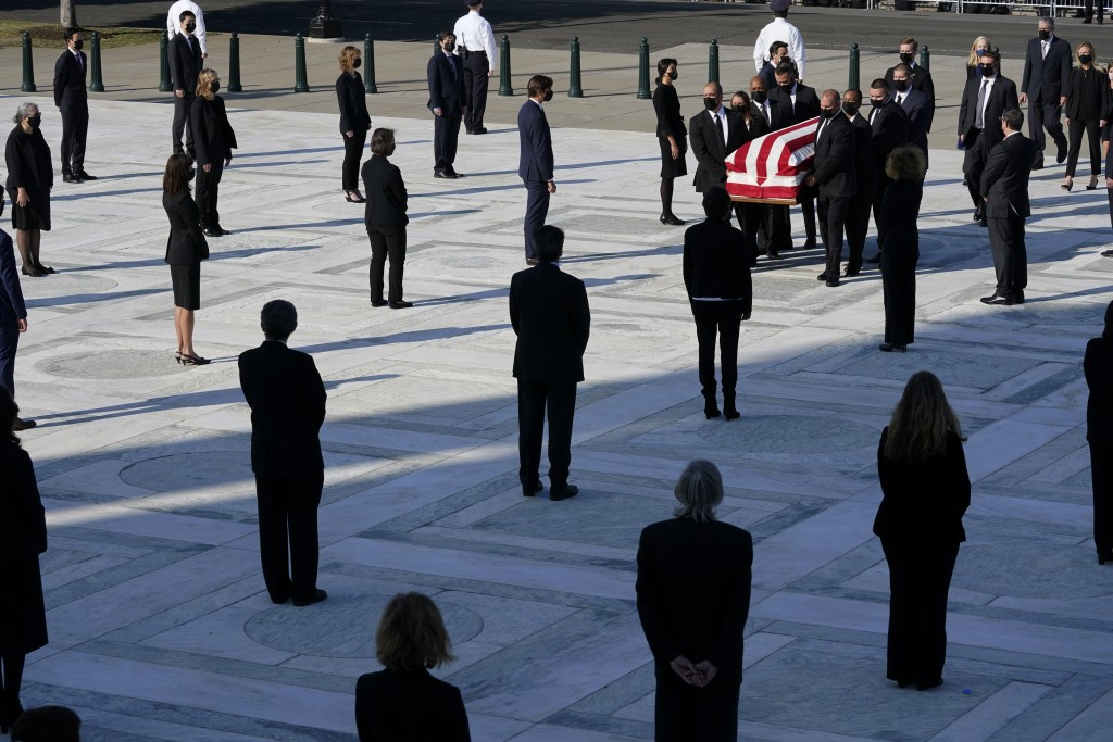 The flag-draped casket of Justice Ruth Bader Ginsburg arrives at the Supreme Court in Washington, Wednesday, Sept. 23, 2020. Ginsburg, 87, died of can...