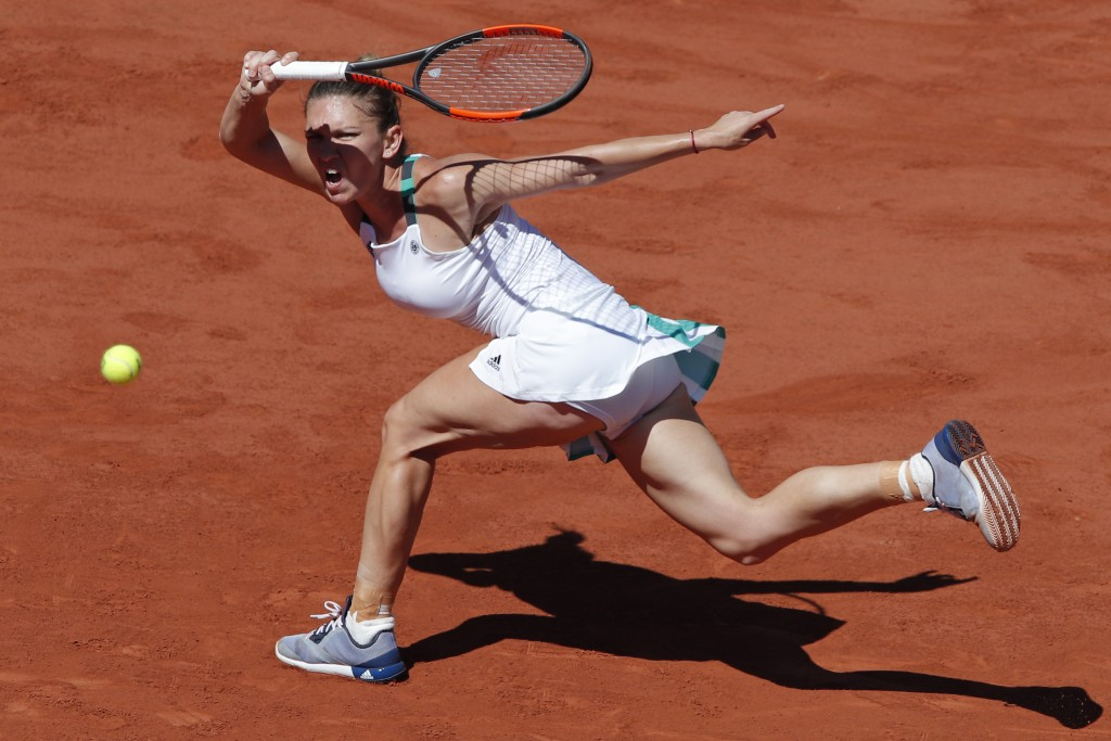 FILE - In this Saturday, June 10, 2017, file photo, Romania's Simona Halep plays a shot against Latvia's Jelena Ostapenko during their women's final m...
