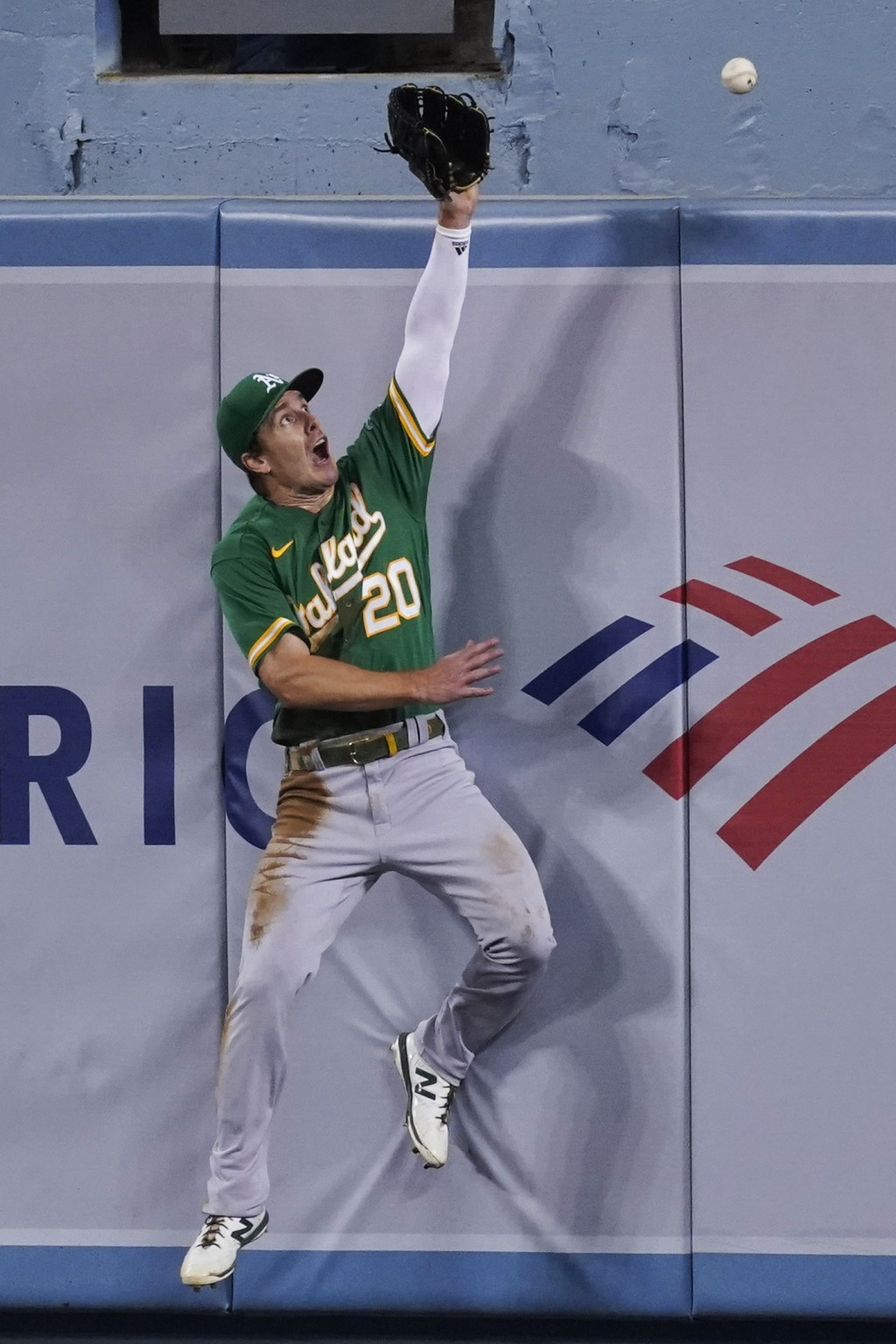 Oakland Athletics center fielder Mark Canha can't make the catch on a home run by Los Angeles Dodgers' A.J. Pollock during the fourth inning of a base...