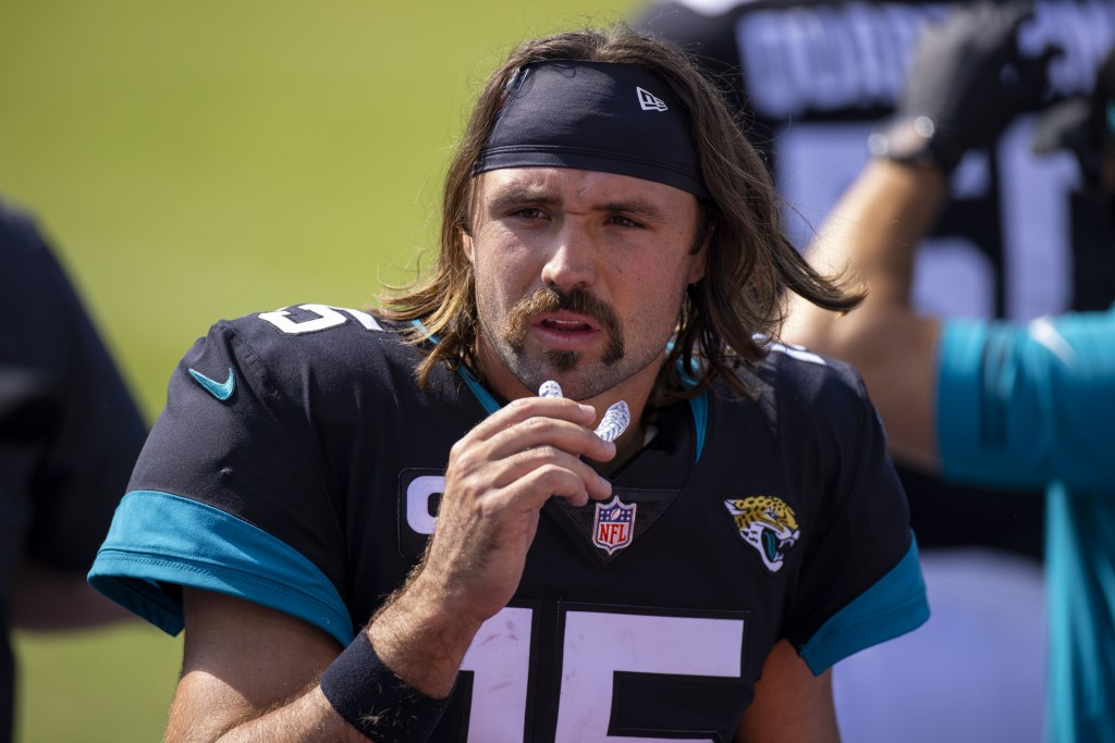 FILE - In this Sept. 20, 2020, file photo, Jacksonville Jaguars quarterback Gardner Minshew (15) walks in the bench area during an NFL football game a...