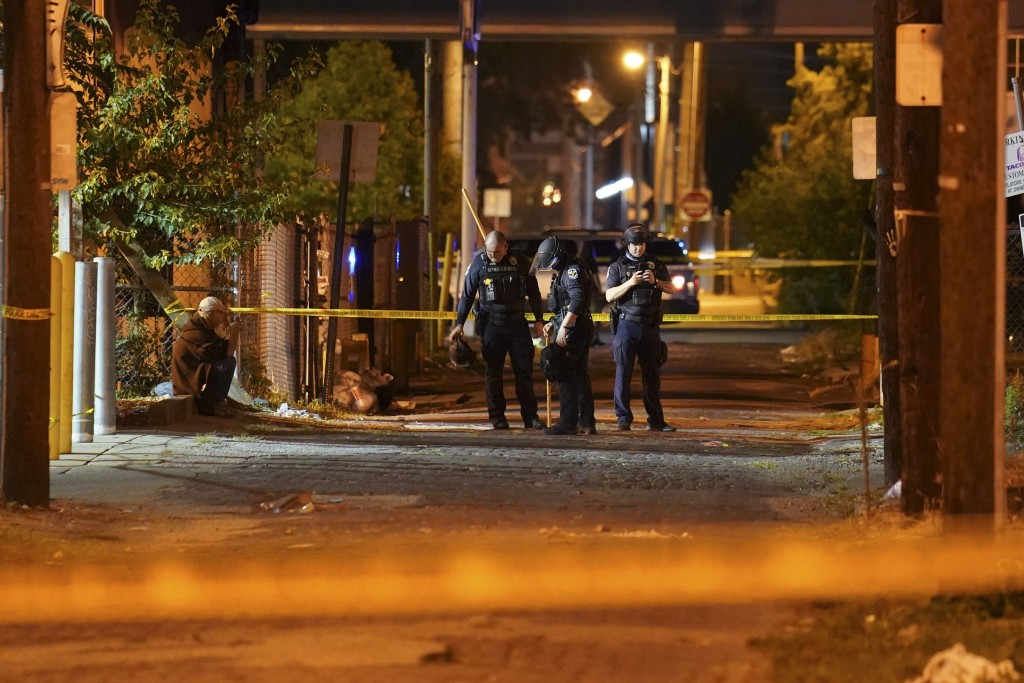 Police survey an area after a police officer was shot, Wednesday, Sept. 23, 2020, in Louisville, Ky. A grand jury has indicted one officer on criminal...