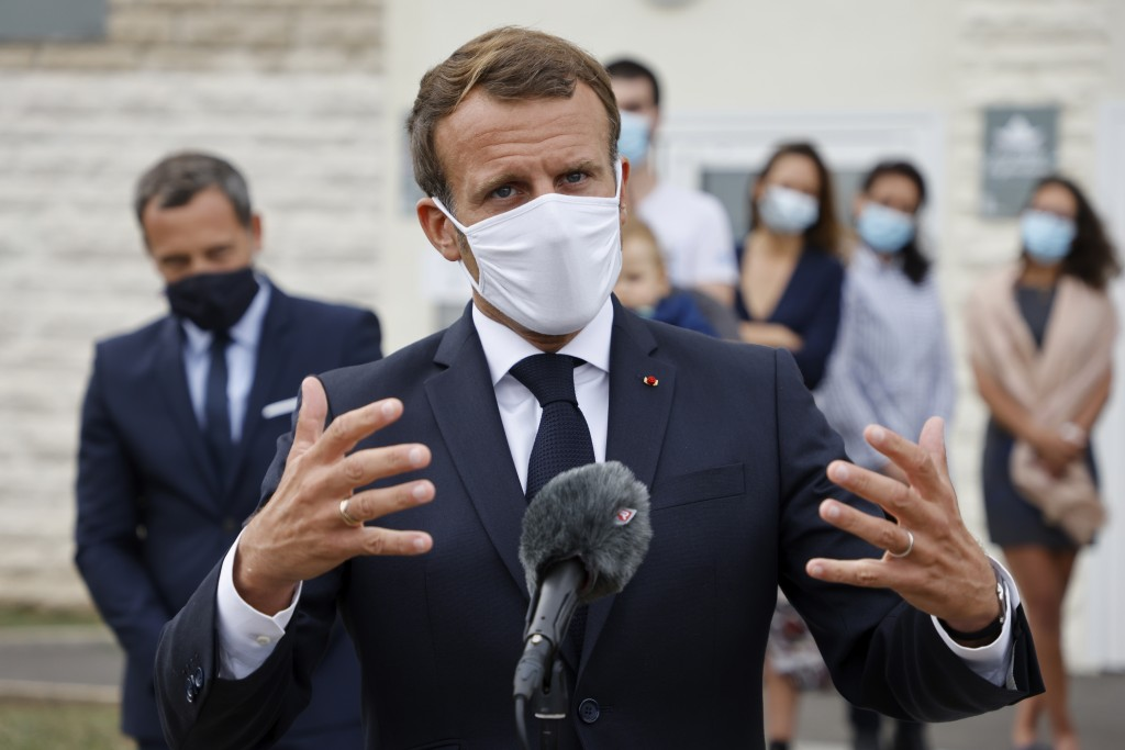 French President Emmanuel Macron speaks after visiting a Mother and Child Protection Centre (PMI) in Longjumeau, a southern suburb of Paris, Wednesday...