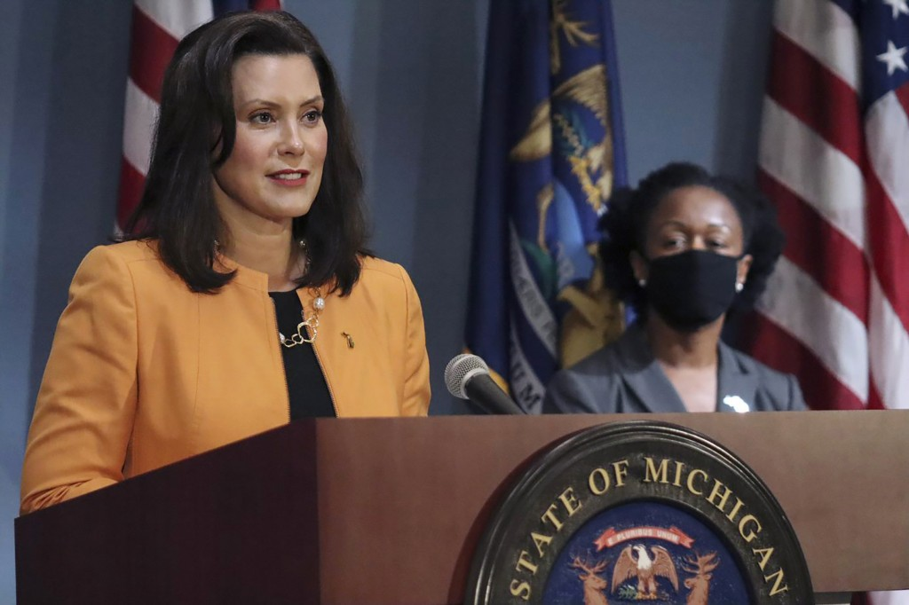 FILE - In this Aug. 19, 2020, file photo, provided by the Michigan Office of the Governor, Michigan Gov. Gretchen Whitmer addresses the state during a...