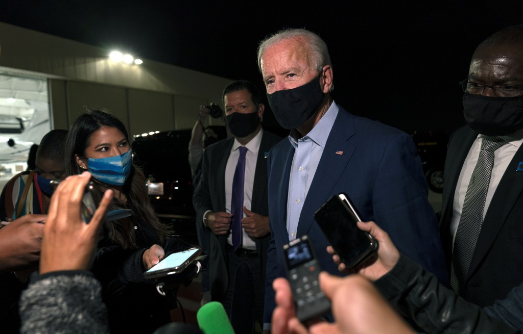 Democratic presidential candidate former Vice President Joe Biden speaks to media as he arrives at New Castle Airport, in New Castle, Del., Wednesday,...
