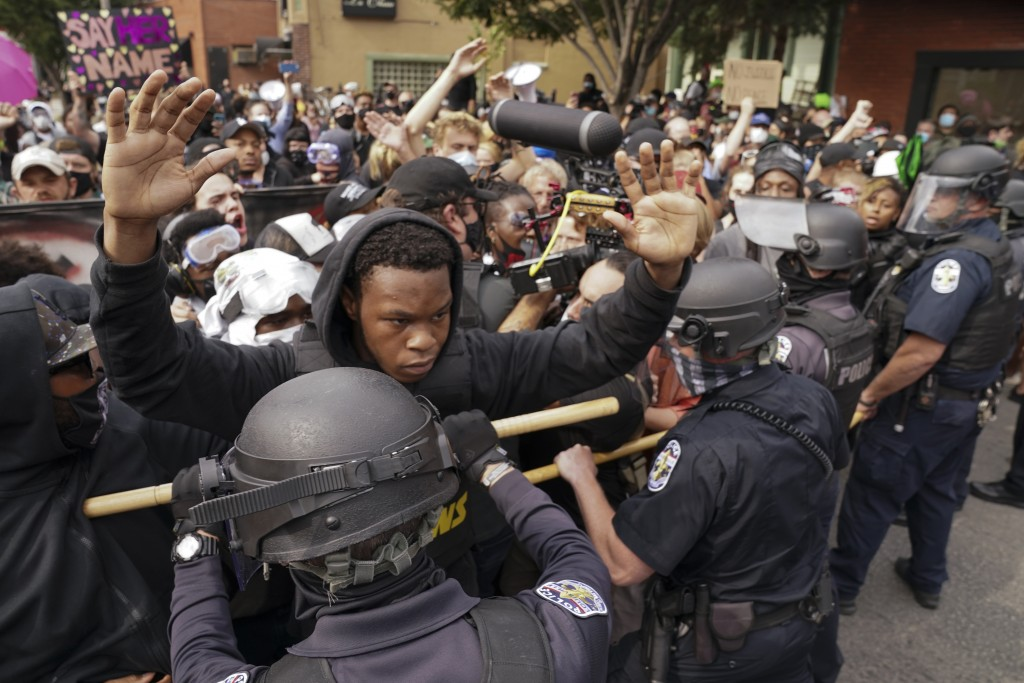 Police and protesters converge during a demonstration, Wednesday, Sept. 23, 2020, in Louisville, Ky. A grand jury has indicted one officer on criminal...