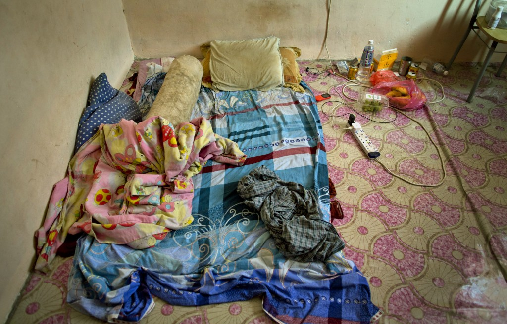 Pillows and blankets are seen in the sleeping area of Bangladeshi palm oil worker, Karim, at a house he shares with others in peninsular Malaysia, Wed...
