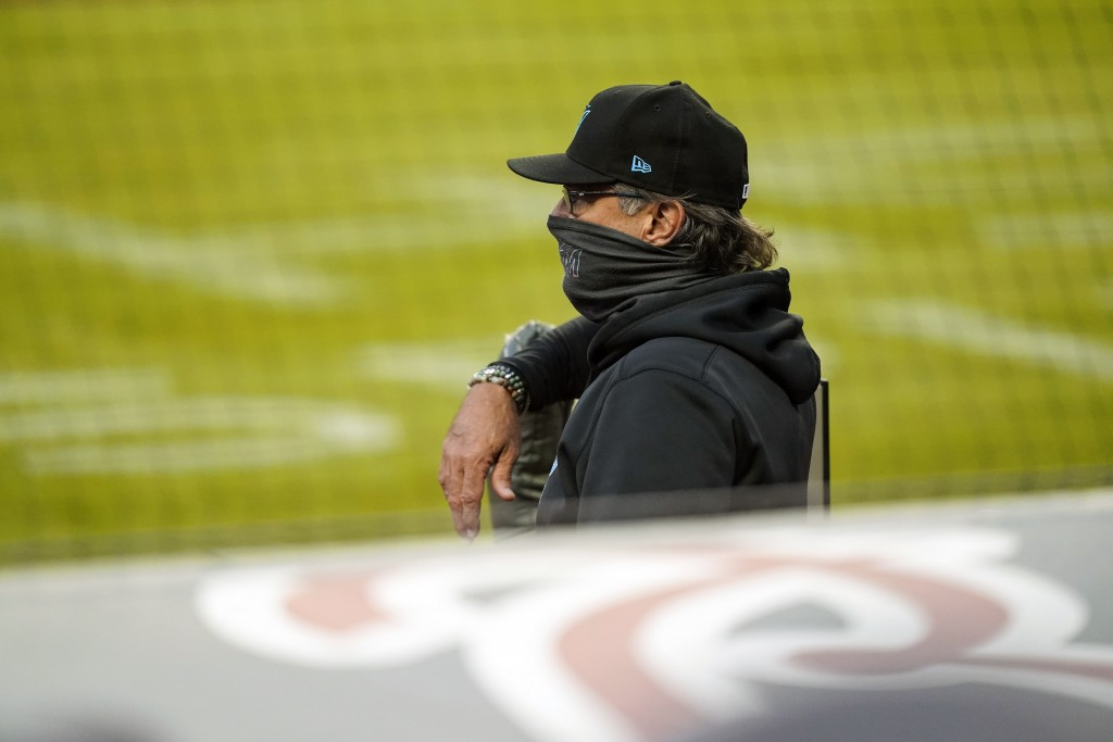 Miami Marlins manager Don Mattingly watches from the dugout during the first inning of the team's baseball game against the Atlanta Braves on Tuesday,...