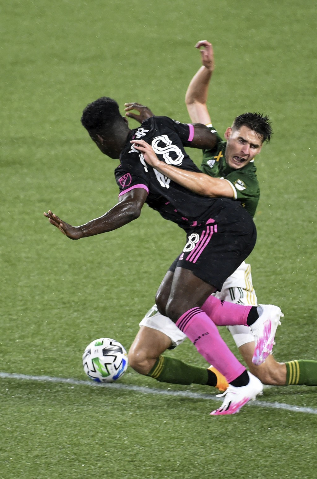 Seattle Sounders defender Yeimar Gomez, left and Portland Timbers forward Jaroslaw Niezgoda compete for the ball during the first half of an MLS socce...