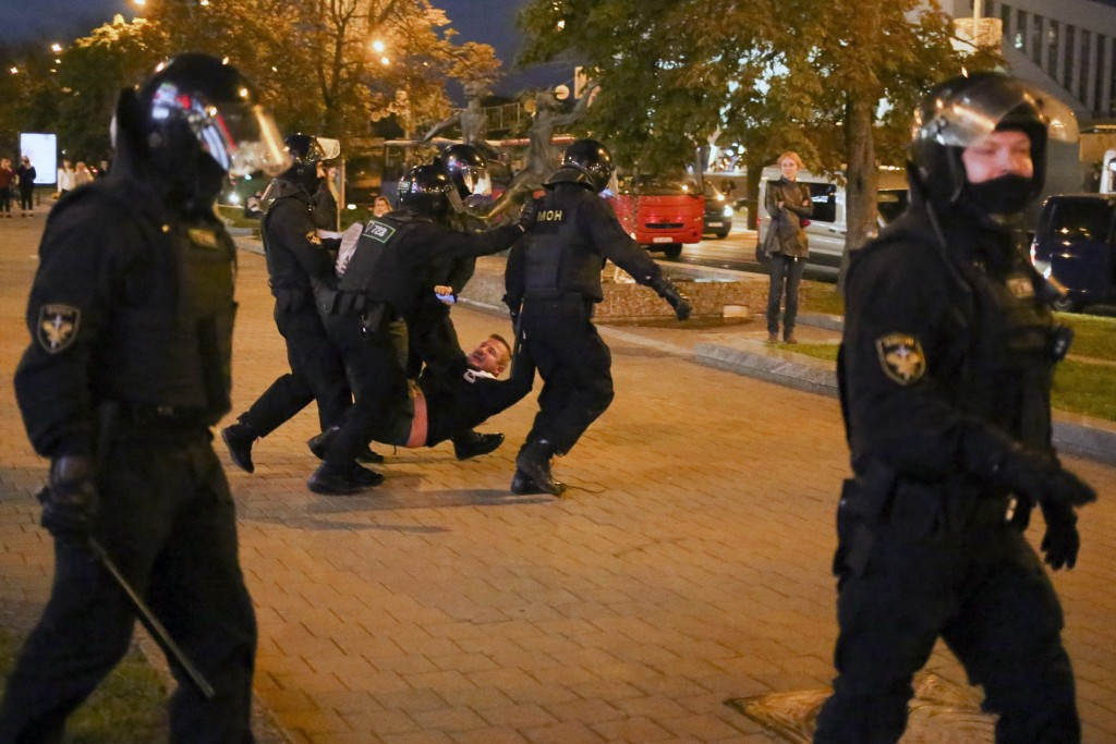 Riot police detain a protester during an opposition rally to protest the presidential inauguration in Minsk, Belarus, Wednesday, Sept. 23, 2020. Belar...