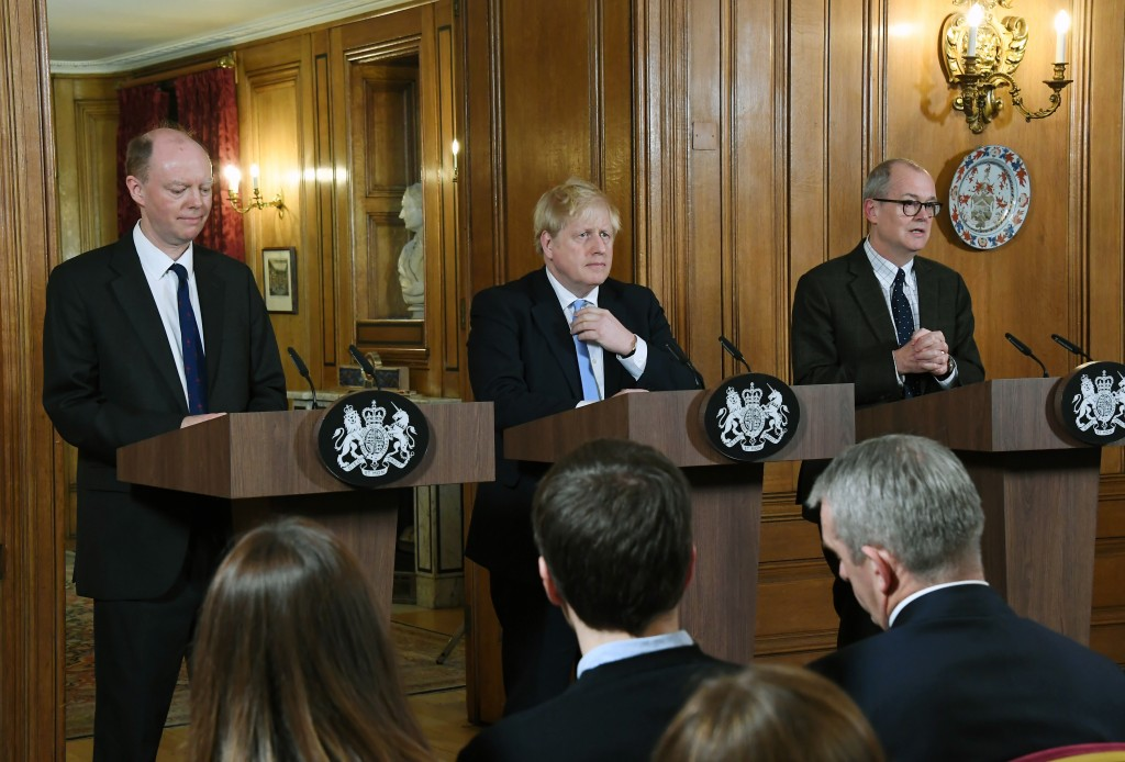 FILE - In this Monday, March 9, 2020 file photo, from left, Chief Medical Officer for England Chris Witty, Britain's Prime Minister Boris Johnson and ...