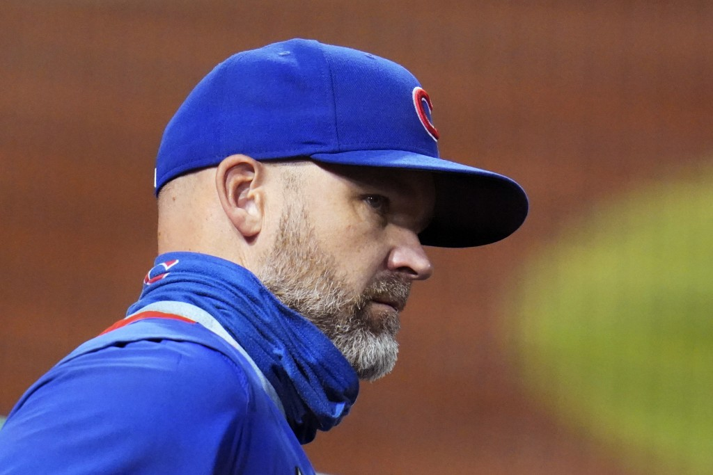 Chicago Cubs manager David Ross stands in the dugout during the first inning of the team's baseball game against the Pittsburgh Pirates in Pittsburgh,...