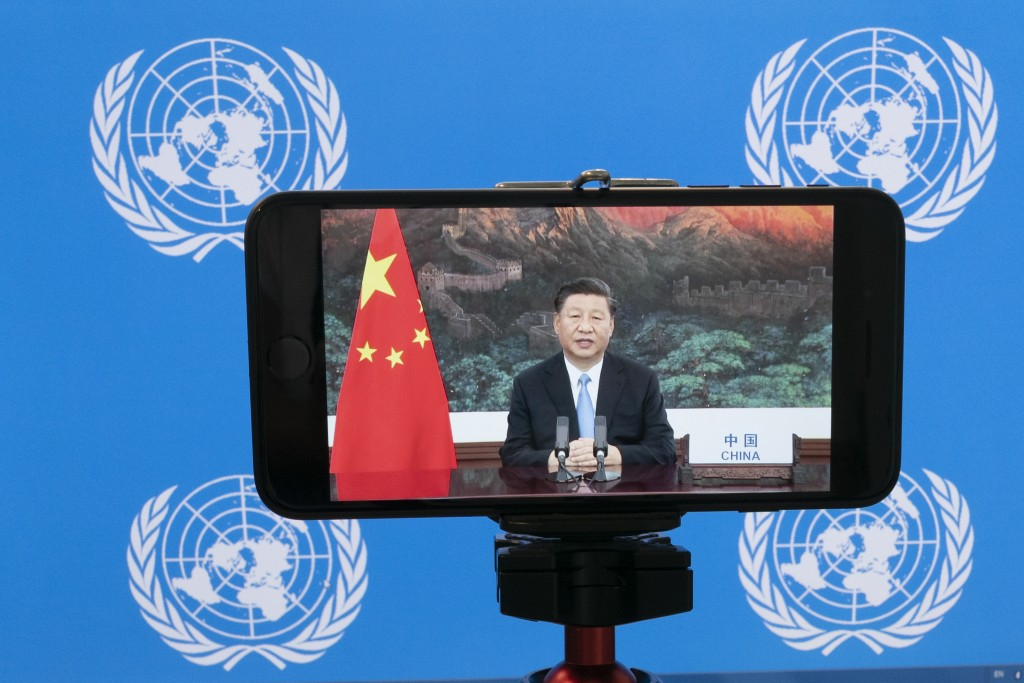 Chinese President Xi Jinping is seen on a video screen remotely addressing the 75th session of the United Nations General Assembly, Tuesday, Sept. 22,...