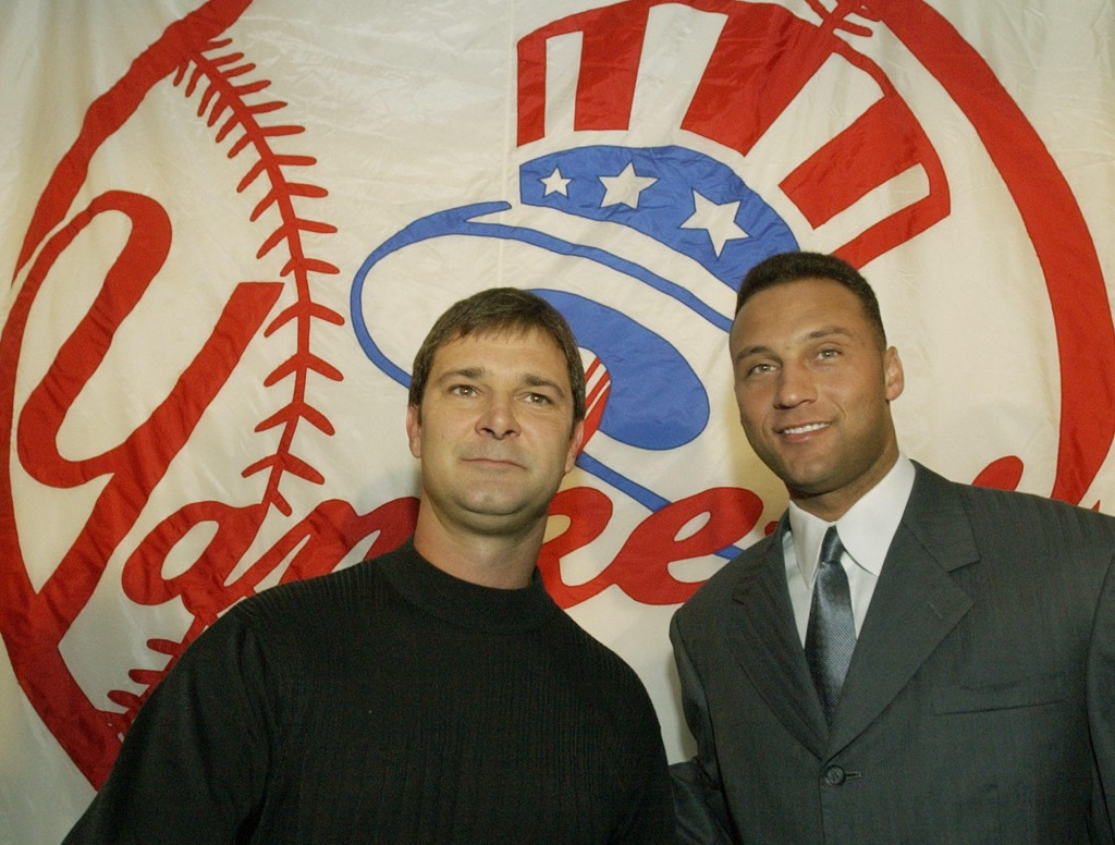 FILE - In this Nov. 4, 2003, file photo, former New York Yankees team captain and newly-named batting coach Don Mattingly, left, poses with current te...
