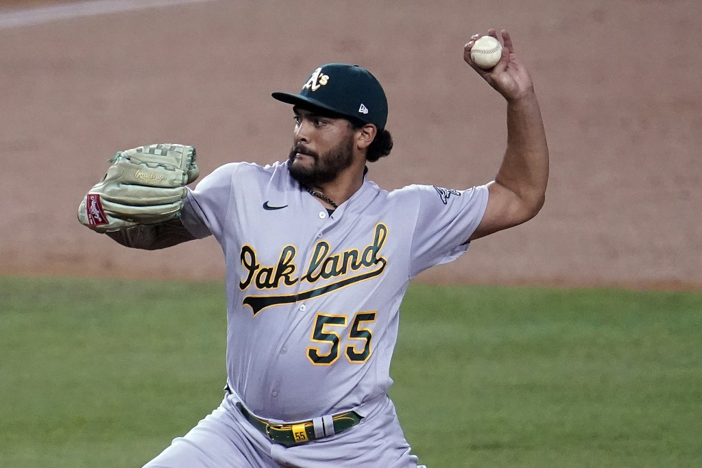 Oakland Athletics starting pitcher Sean Manaea throws to a Los Angeles Dodgers batter during the first inning of a baseball game Wednesday, Sept. 23, ...