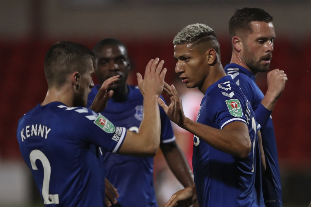 Everton's Richarlison, right, celebrates after scoring his side's opening goal during the English League Cup third round soccer match between Fleetwoo...
