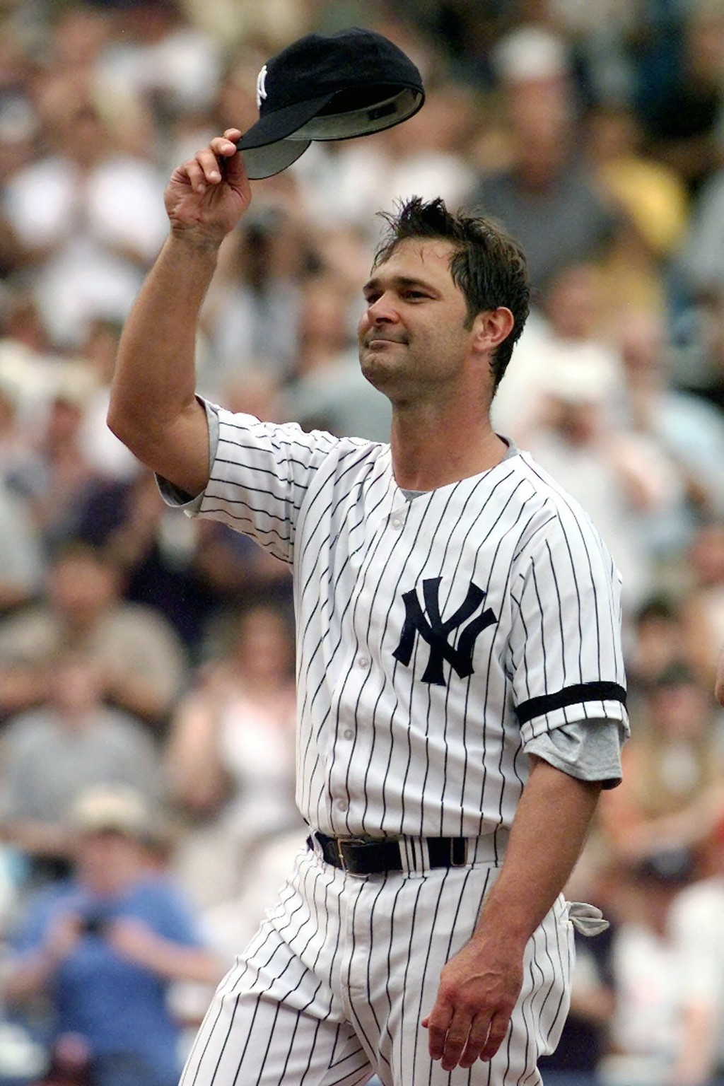 FILE - In this Sept. 2, 2000, file photo, New York Yankees' Don Mattingly tips his cap to the crowd as he is introduced for the first time during Old ...