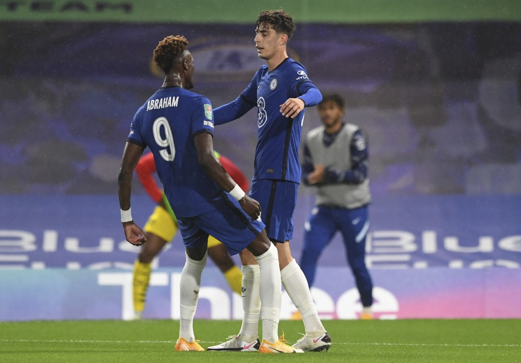 Chelsea's Kai Havertz, right, celebrates with his teammate Tammy Abraham, after scoring his team's second goal during the English League Cup third rou...