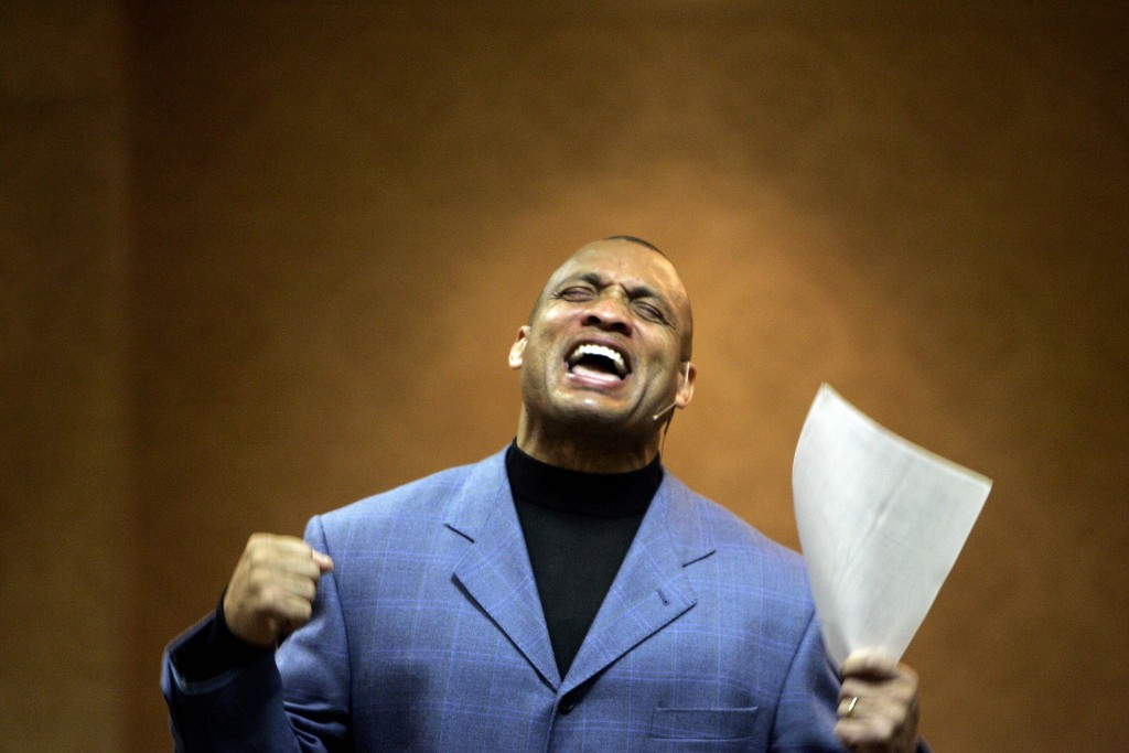 File-Former NFL football player Aeneas Williams takes part in services at his church Sunday, Dec. 14, 2008, in Clayton, Mo. After shutting down receiv...