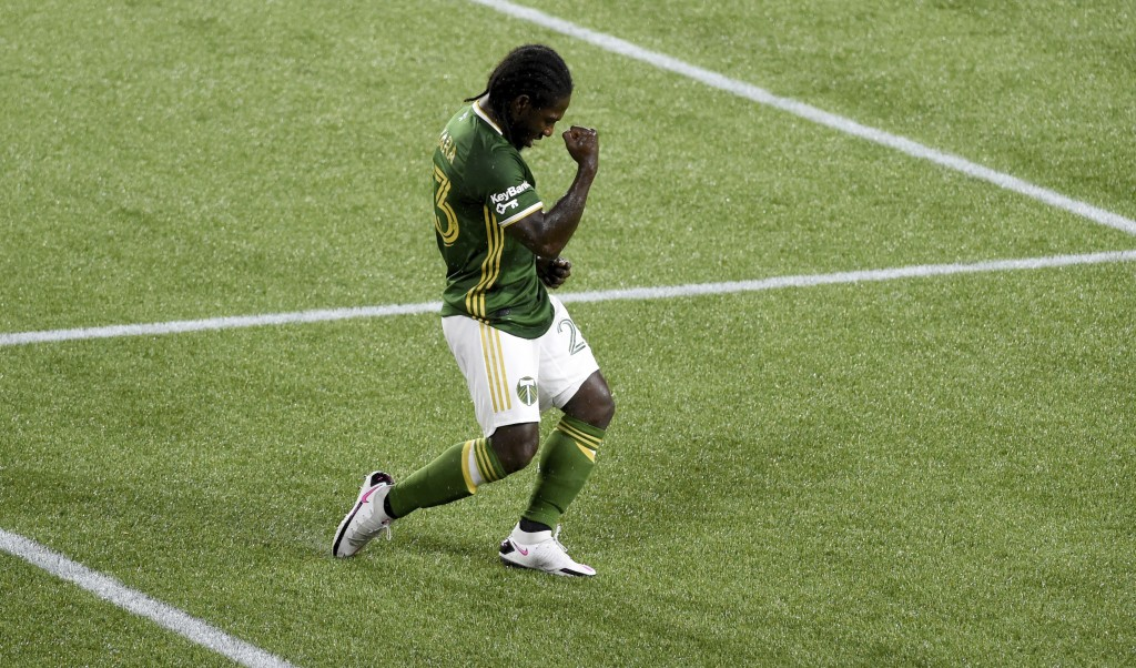 Portland Timbers forward Yimmi Chara celebrates after scoring a goal during the first half of the team's MLS soccer match against the Seattle Sounders...