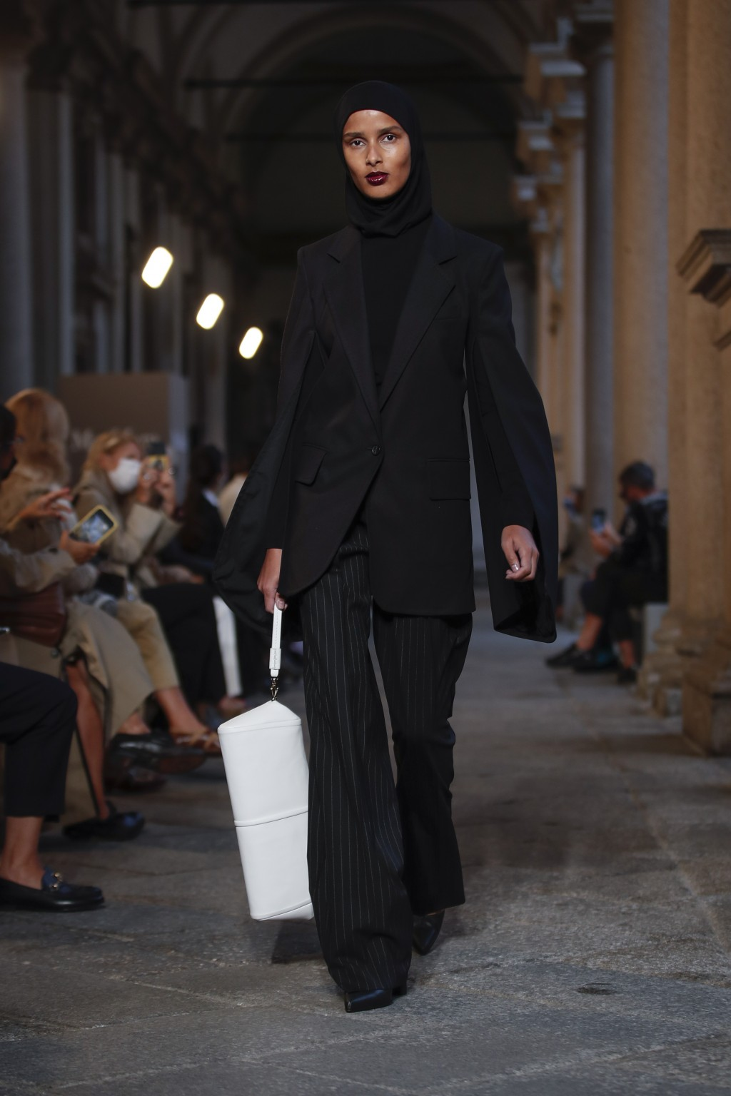 A model wears a creation as part of the Max Mara 2021 women's spring-summer ready-to-wear collection during the Milan's fashion week in Milan, Italy, ...