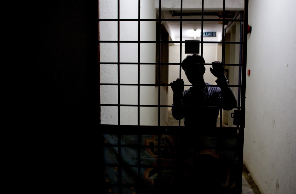 Sayed, a member of Myanmar's long-persecuted Rohingya minority, stands behind a metal door at the entrance of a friend's house in peninsular Malaysia ...