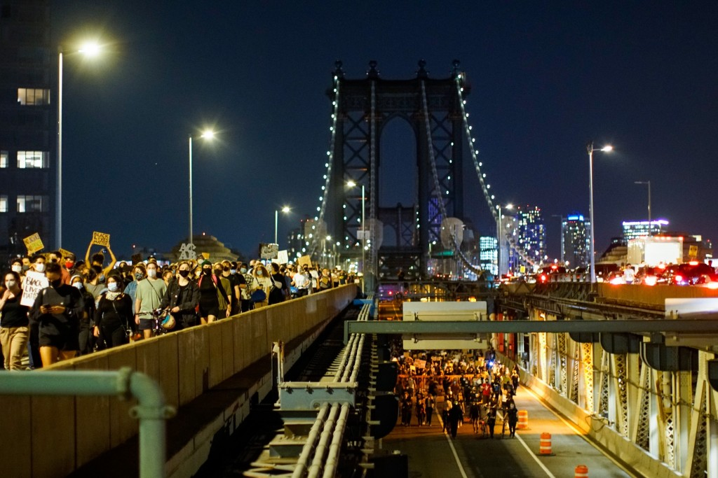 Protesters march across the Manhattan Bridge, Wednesday, Sept. 23, 2020, in New York, following a Kentucky grand jury's decision not to indict any pol...