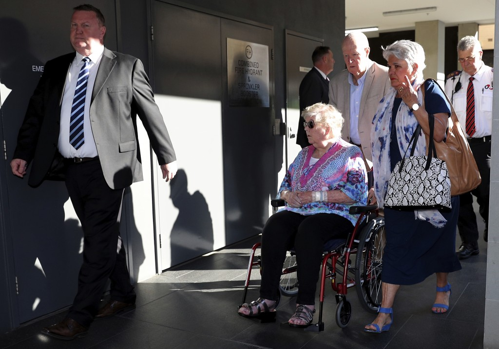 Jenny Rimmer, center, mother of Jane Rimmer, arrives at the Supreme Court of Western Australia in Perth, Thursday, Sept. 24, 2020. A judge found a man...