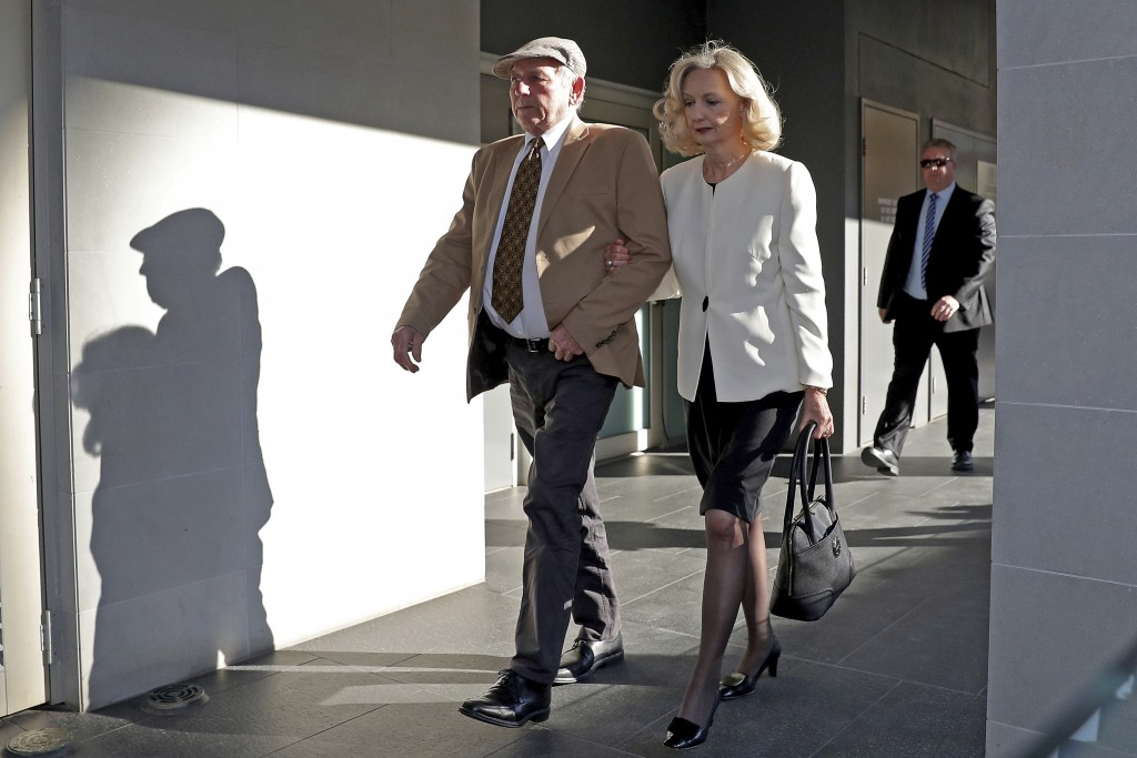 Don Spiers, left, and Carol Spiers, center, the parents of Sarah Spiers, arrive at the Supreme Court of Western Australia in Perth, Thursday, Sept. 24...
