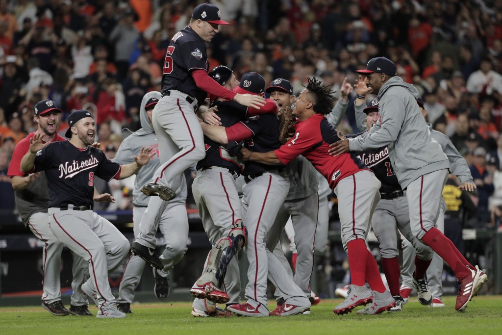 FILE - In this Wednesday, Oct. 30, 2019, file photo, The Washington Nationals celebrate after Game 7 of the baseball World Series against the Houston ...