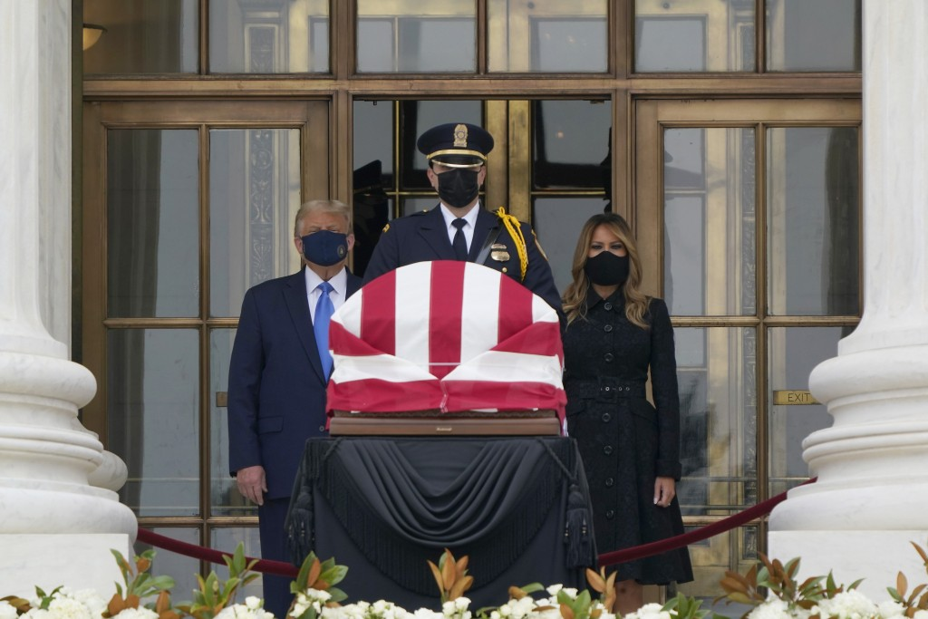 President Donald Trump and first lady Melania Trump pay respects as Justice Ruth Bader Ginsburg lies in repose at the Supreme Court building on Thursd...