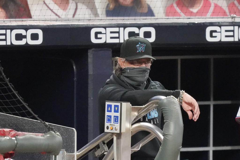 Miami Marlins manager Don Mattingly looks out onto the field during the team's baseball game against the Atlanta Braves on Tuesday, Sept. 22, 2020, in...