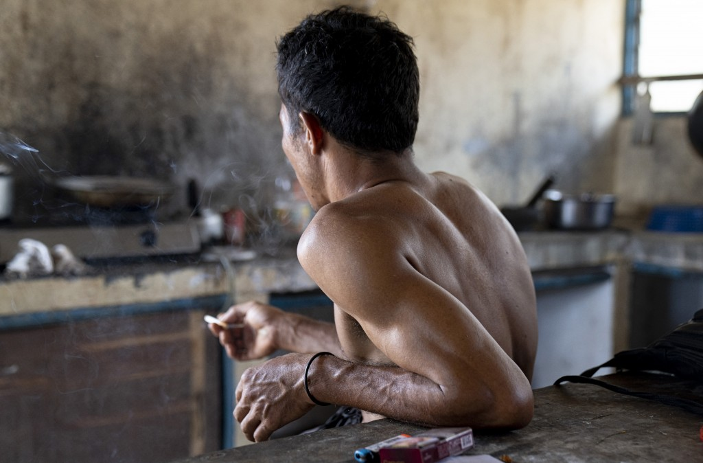 An Indonesian migrant worker rests after working on a palm oil plantation run by the government-owned Felda in Malaysia, in early 2020. Jum, a former ...