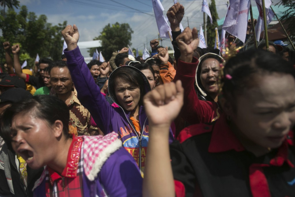 Palm oil workers hold a rally demanding to be treated fairly in Rantau Prapat, North Sumatra, Indonesia, on Nov. 15, 2017. The Associated Press has fo...