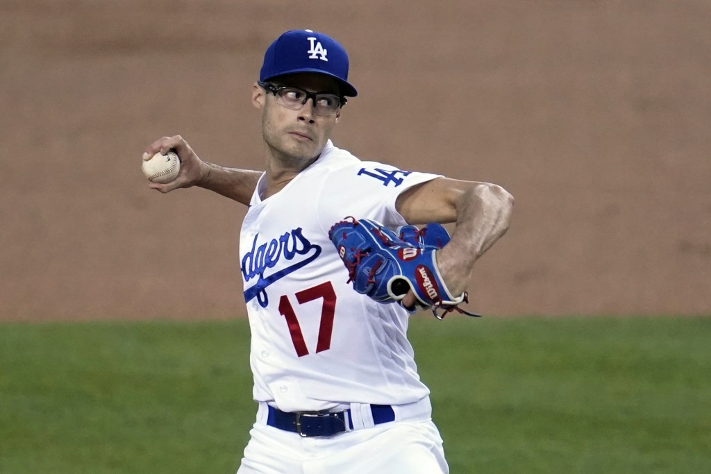 Los Angeles Dodgers starter Joe Kelly throws to an Oakland Athletics batter during the first inning of a baseball game Wednesday, Sept. 23, 2020, in L...