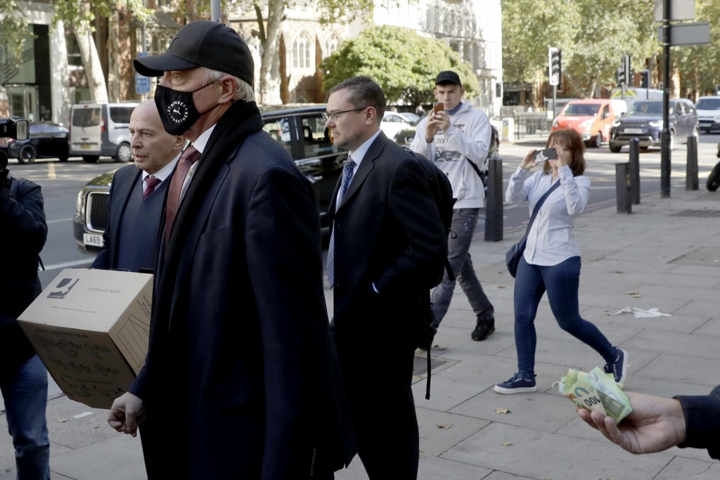 Retired German tennis star Boris Becker leaves Westminster Magistrates Court in London, after being declared bankrupt and accused of not complying wit...