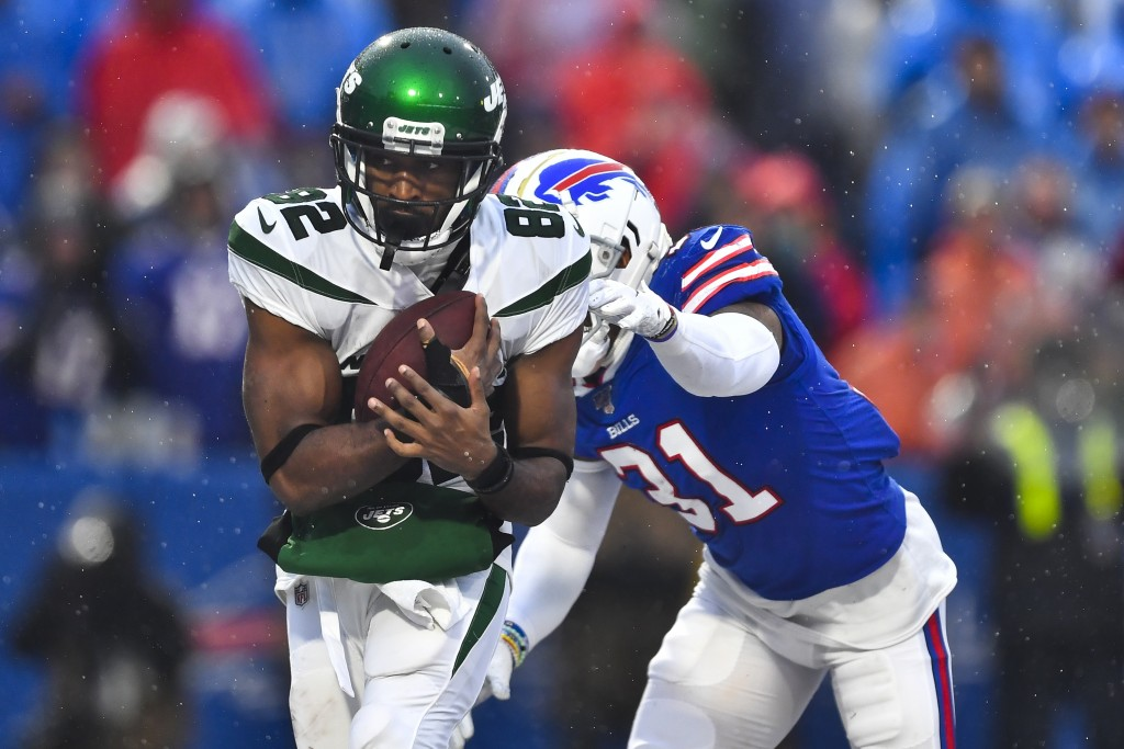 File-New York Jets wide receiver Jamison Crowder (82) catches a pass for a touchdown in front of Buffalo Bills' Dean Marlowe (31) during the second ha...