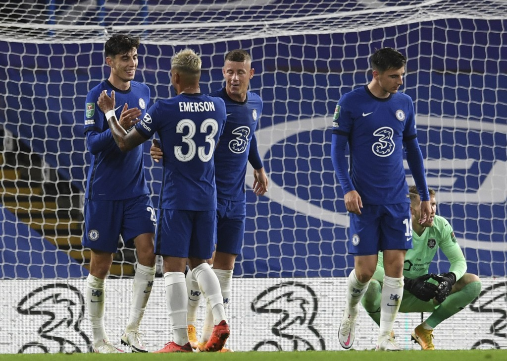 Chelsea's Kai Havertz, left, celebrates with his teammates after scoring his teams fifth goal, during the English League Cup third round soccer match ...