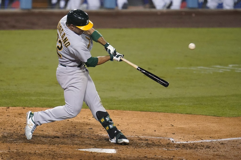 Oakland Athletics' Ramon Laureano swings for a two-run home run during the ninth inning of the team's baseball game against the Los Angeles Dodgers on...