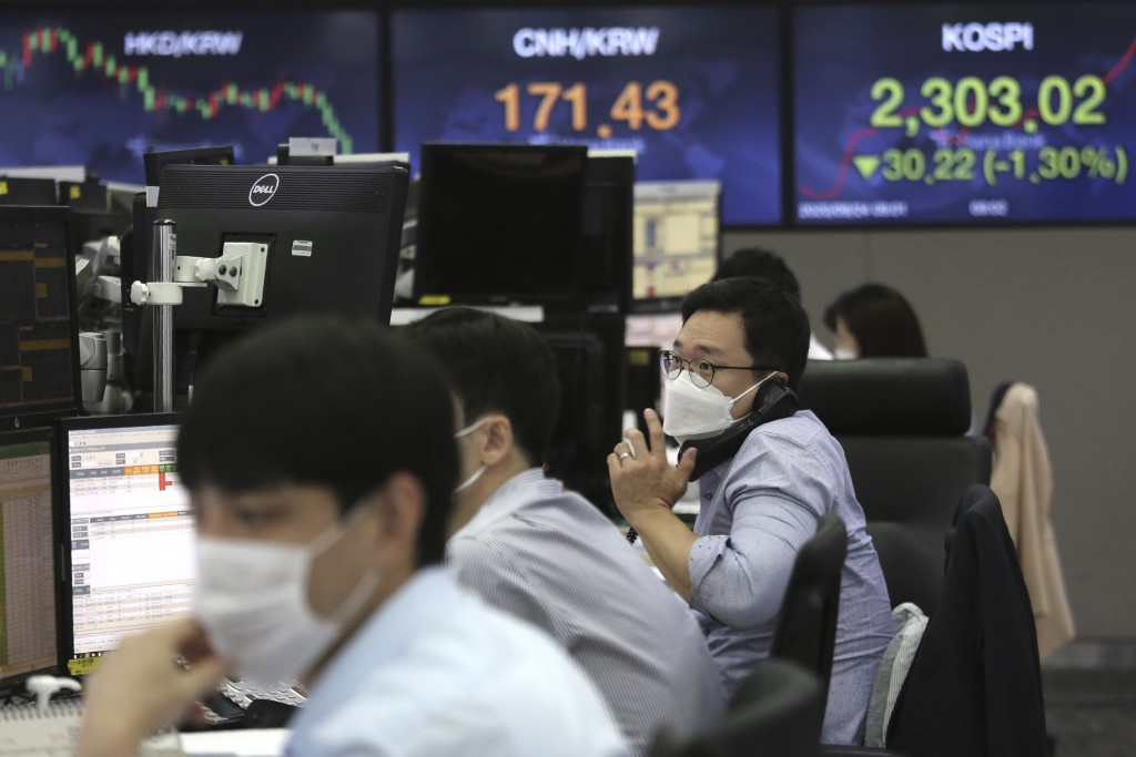 A currency trader talks on the phone at the foreign exchange dealing room of the KEB Hana Bank headquarters in Seoul, South Korea, Thursday, Sept. 24,...