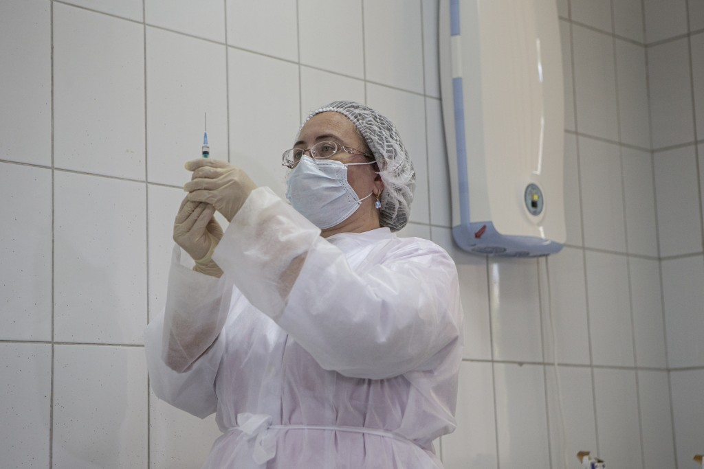 FILE - In this Tuesday, Sept. 15, 2020, file photo, a Russian medical worker prepares a shot of Russia's experimental Sputnik V coronavirus vaccine fo...