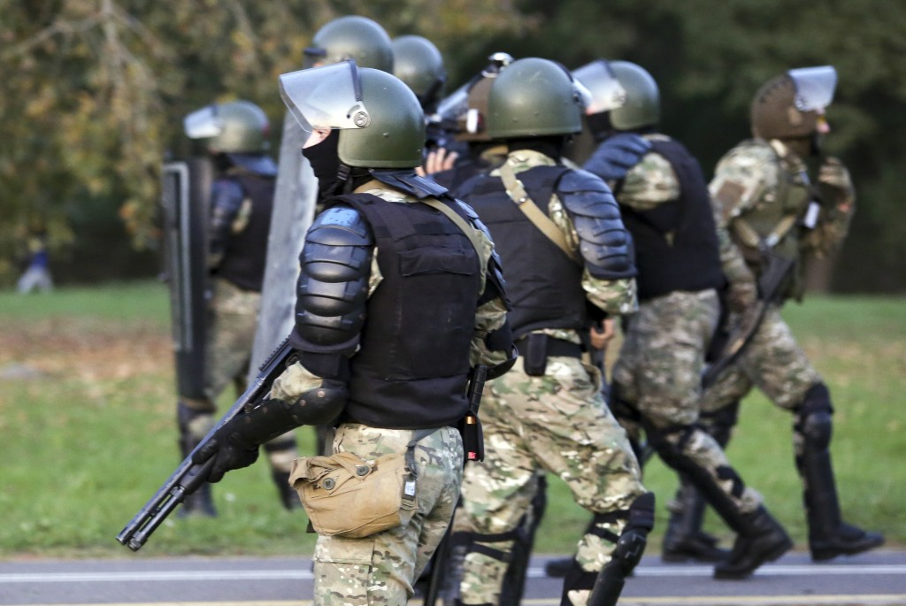 Riot police get ready during an opposition rally to protest the presidential inauguration in Minsk, Belarus, Wednesday, Sept. 23, 2020. Belarus Presid...