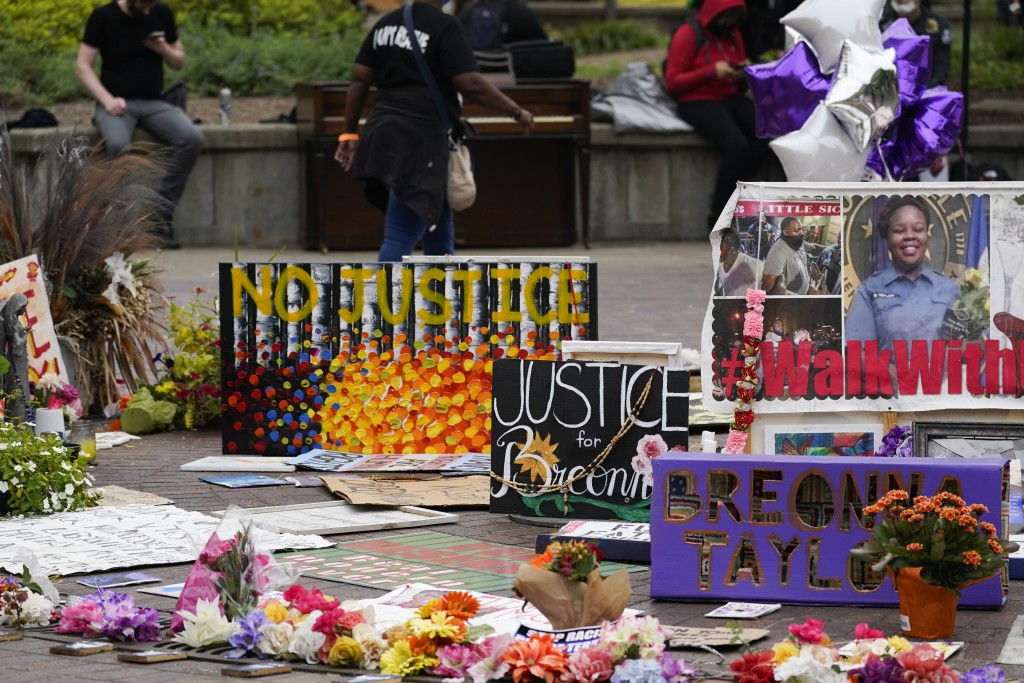 People gather in Jefferson Square awaiting word on charges against police officers, Wednesday, Sept. 23, 2020, in Louisville, Ky. A grand jury has ind...