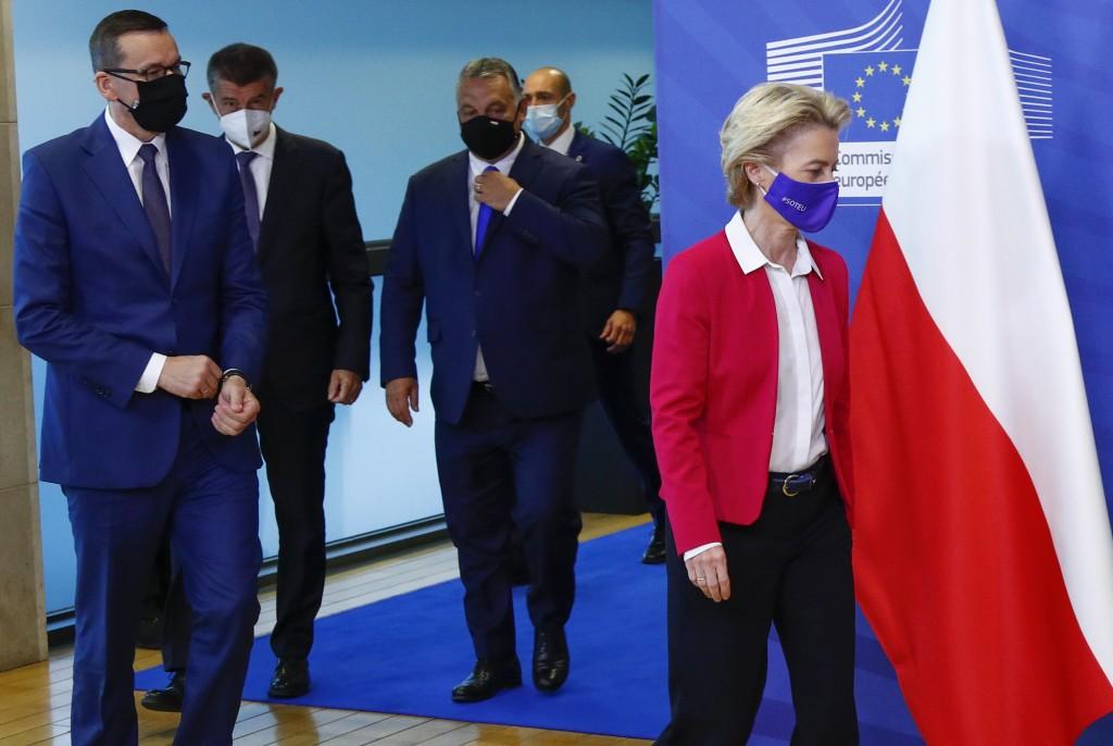 From left, Poland's Prime Minister Mateusz Morawiecki, Czech Republic's Prime Minister Andrej Babis and Hungary's Prime Minister Viktor Orban follow b...