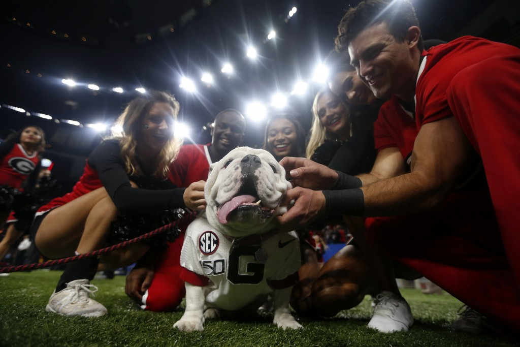 "Georgia cheerleaders pose with the school mascot ""Uga"" before the Sugar Bowl NCAA college football game against Baylor in New Orleans, Wednesday, Jan...."