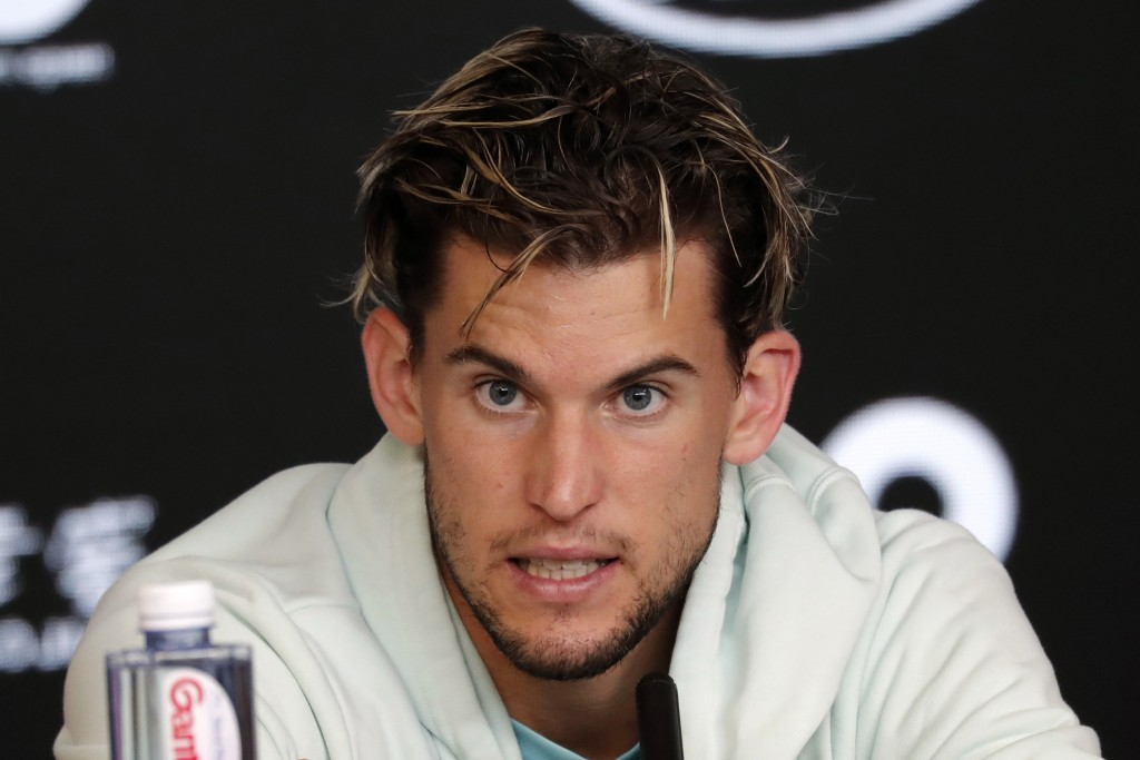 FILE - In this Monday, Feb. 3, 2020, file photo, Austria's Dominic Thiem speaks at a press conference following his loss to Serbia's Novak Djokovic in...