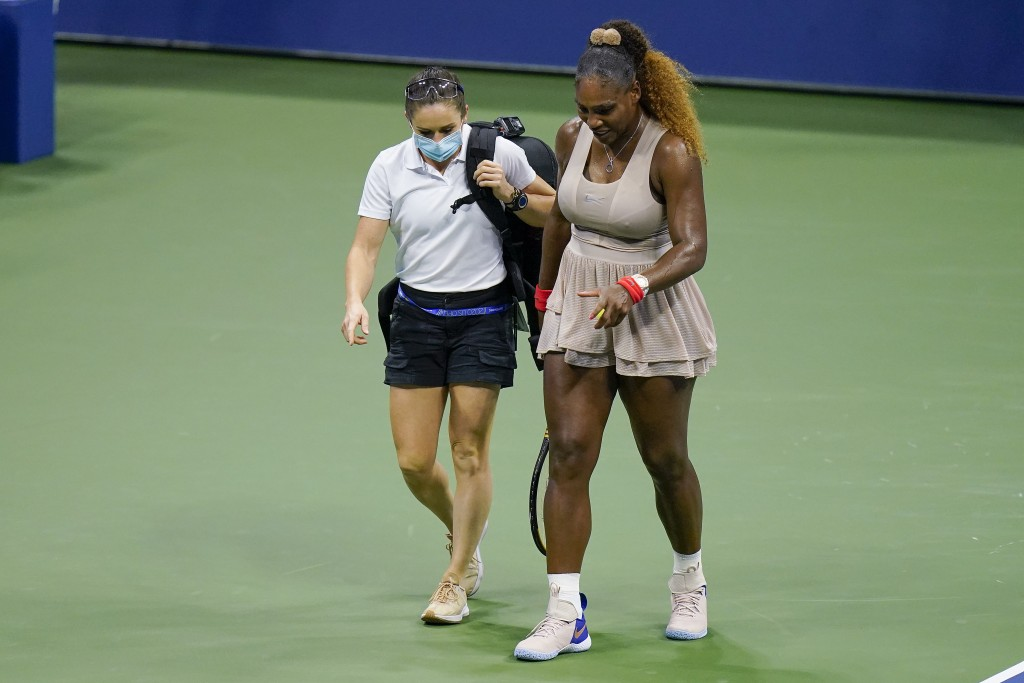 FILE - In this Sept. 10, 2020, file photo, Serena Williams walks to her bench with a trainer for a medical timeout during a semifinal match of the U.S...