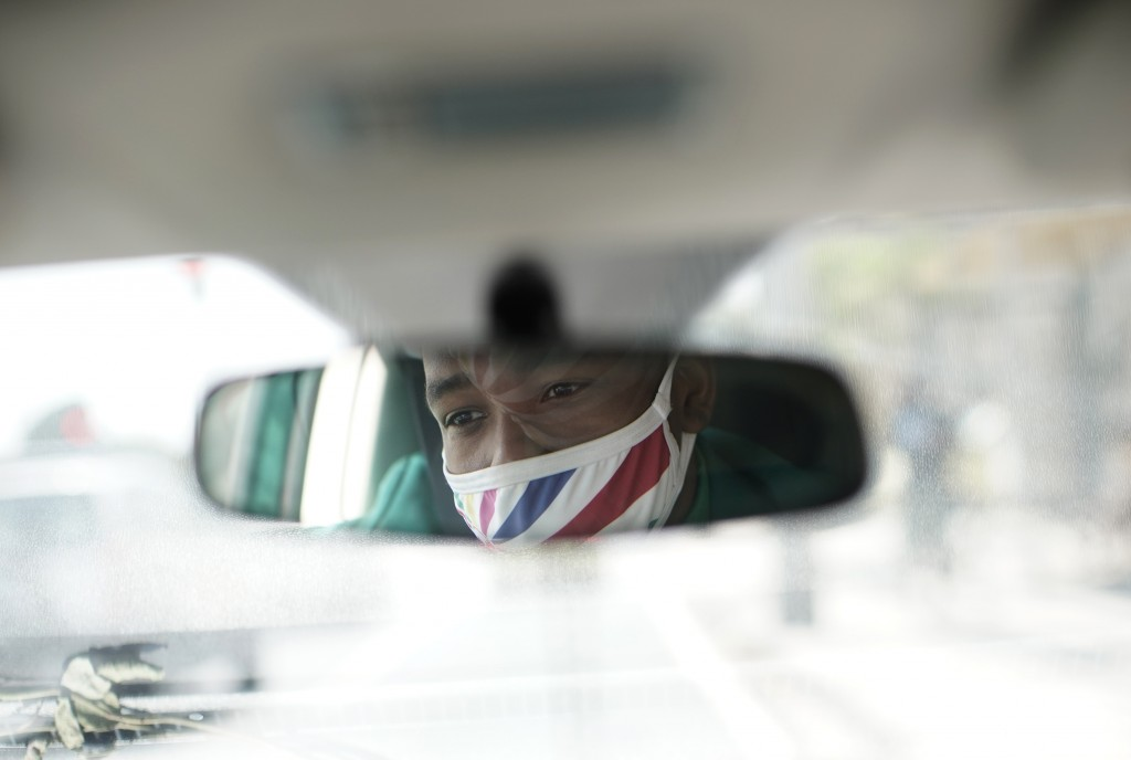 Diogo Jesus, the main dancer for the Mocidade Independente de Padre Miguel samba school, is rfelected in a rearview mirror of his car his, in Rio de J...