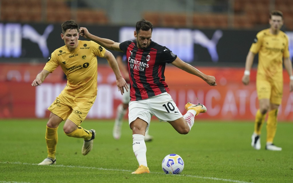 AC Milan's Hakan Calhanoglu scores his side's opening goal during the Europa League, third-round qualifying soccer match between AC Milan and Bodoe/Gl...